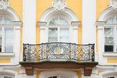 Baroque balcony on facade of house — Stock Photo