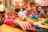 Two girls in playroom — Stock Photo