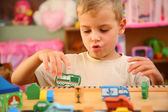Boy plays in playroom — Stock Photo