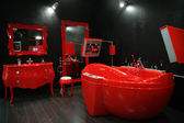 Cool red bathroom — Stock Photo