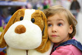 Girl with soft toy — Stock Photo