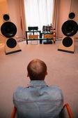 Man listens music from vinyl — Stock Photo