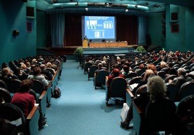 Conference in auditorium