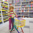 Little girl in bookshop - Stock Photo