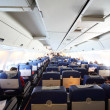 Airplane cabin with passengers general view — Stock Photo