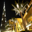 Night Dubai street, palms with decor lamps and Burj Dubai, Unite — Stock Photo