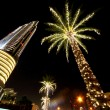 Royalty-Free Stock Photo: Night Dubai palms with decor lamps and skyscraper, United Arab E