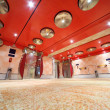 Modern luxury hall with bright red ceiling and lifts general vie — Stock Photo #7936503