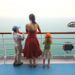 Little boy and girl with mother standing on ship deck and lookin — Stock Photo