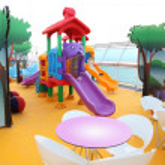 Little boy slide on bright colorful children's playground on cru — Stock Photo