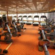 Large gym hall with treadmills and exercise bicycle in cruise sh — Stock Photo