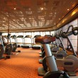 Large gym hall with treadmills and exercise bicycle in cruise sh - Stock Photo
