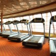 Large gym hall with treadmills near windows in cruise ship — Stock Photo