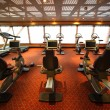 Large gym hall with exercise bicycle in cruise ship view from ba — Stock Photo