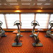 Large gym hall with exercise bicycle near window in cruise ship - Stock Photo
