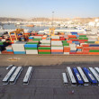 Shipping port with buses and containers for cargo transportation - Stock Photo