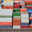Multicolored containers for cargo transportation on ship - Stock Photo