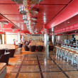 Cafe with bright multicolored interior, bar and red celling gene — Foto Stock