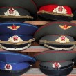 Ussr polisman uniform hats with visor on wooden shelf - Stock Photo