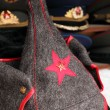 Budenny hat Red Army uniform with red star and police hats on ba - Stock Photo