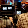 Two video operators controlling camerat performance show view — Stock Photo #7936662