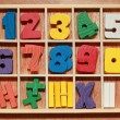 Math game for junior age with colored wooden signs of numbers — 图库照片