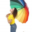 Young attractive woman in yellow shirt with multicolored umbrell — Stock Photo