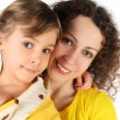 Portrait of mother and daughter in yellow dress smiling and look — Stock Photo #7936838