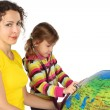 Mother and little girl with stethoscope and big inflatable globe — Stock Photo