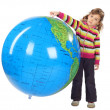 Little girl standing and holding big inflatable globe, isolated — Stock Photo