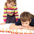 Little serious boy and girl playing with wooden railway, focus o — Stock Photo
