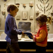 Boy and little girl at excursion in historical museum near exhib — Stock Photo
