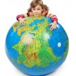 Little girl look out of big inflatable globe and embracing it, i — Stock Photo #7936919