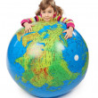 Little girl look out of big inflatable globe and embracing it, i - Stock fotografie