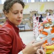 Mother in a supermarket — Stock Photo