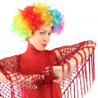 Portrait of young attractive woman in clown wig and red shawl, h — Stock Photo
