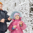 Cheerful boy and little girl with petard in hands in winter in w — Stock Photo