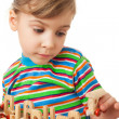 Pretty little girl is played by toy wooden steam locomotive with — Stock Photo