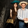 Young beautiful woman and smiling man in sombrero and with drum - Stock Photo