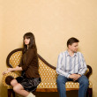 Young woman and young man sitting on sofa in room — Stock Photo #7937264