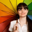Smiling young brunette woman in white blouse with multi-coloured — Stock Photo #7937420