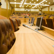 Conference halls with magnificent leather armchairs and wooden t — Stock Photo #7937421