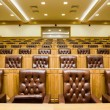 Conference halls with magnificent leather armchairs and wooden t — Stock Photo #7937429