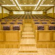 Conference halls with magnificent leather armchairs and wooden t — Stock Photo #7937472