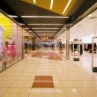 Shopping centre corridor, Shops with wide choice of clothes — Stock Photo #7937476