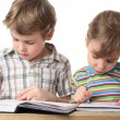 Little caucasian boy and girl are painting in notebooks, half bo — Stock Photo