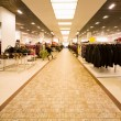 Big shop of clothes, autumn clothes and collection of female bag — Foto Stock