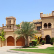 Big arabian style house with two garages and archs, yard with pa — Stock Photo #7937718
