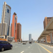 DUBAI - APRIL 18: trunk road and skyscrapers on April 18, 2010 i — Stock Photo