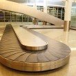 Empty baggage carousel in airport hall with granite floor and gl — Stock Photo #7937809